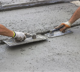 Workers Leveling Concrete with Trowels